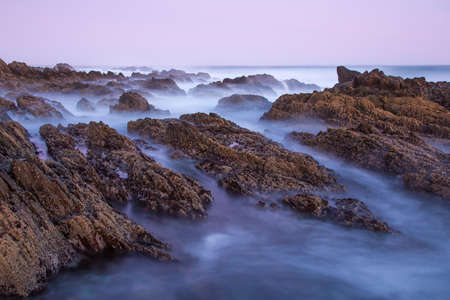 Long exposure of the sea waves over the rocks at the coast Reklamní fotografie