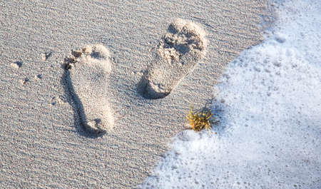Footprints and Sea Water on a Sandy Tropical Beach Reklamní fotografie