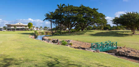 A water hazard and bridge on a beautiful tropical golf coarse
