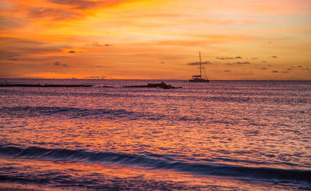 Magnificent glowing tropical sunset at the coast in Barbados Reklamní fotografie