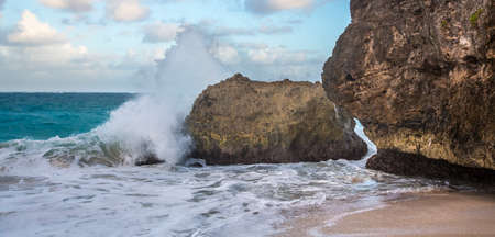 Waves crashing over rocks on the coast of Barbados