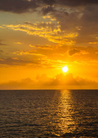 Beautiful golden sunset over the sea at the coast in Jamaica