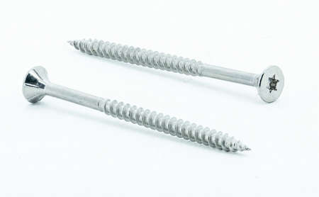Two shiny stainless steel wood screws on white background