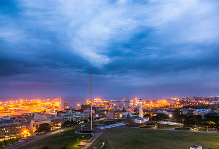 Landscape view of Port Elizabeth Harbour and Donkin Reserve and Lighthouse at Nightfall