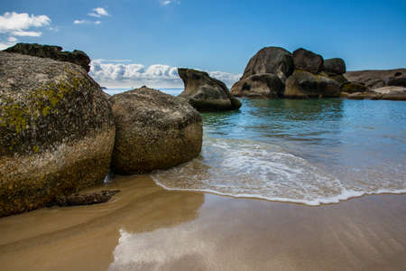 Tranquil sea and boulders in Cape Town, South Africa