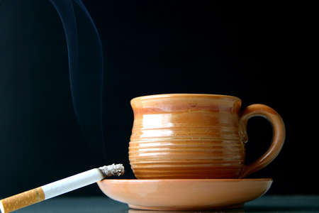 Quick breakfast- a cup of coffee/tea with a cigarette Imagens