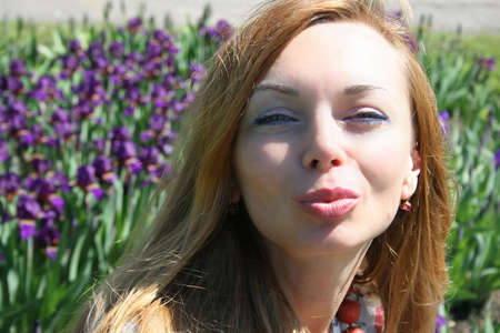 Portrait of the kissing beautiful young woman photo