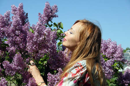 Pretty young woman among lilacs Stock Photo - 944278