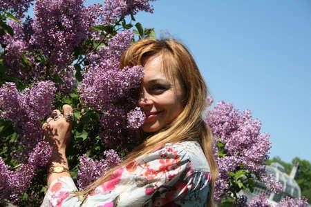 Pretty young woman among lilacs Stock Photo - 944279