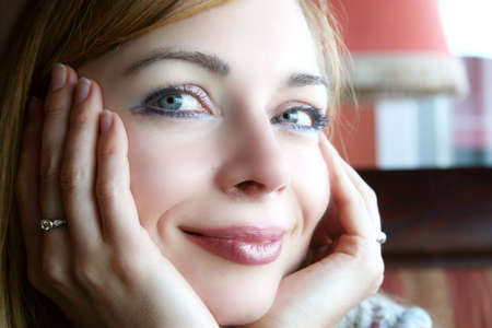 Smiling young, pretty woman portrait, in a restaurant