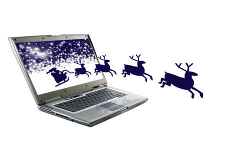 Santa Claus is coming from the monitor photo
