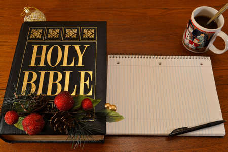 Christmas Bible, notebook & coffee on table-(place for text on notebook) photo