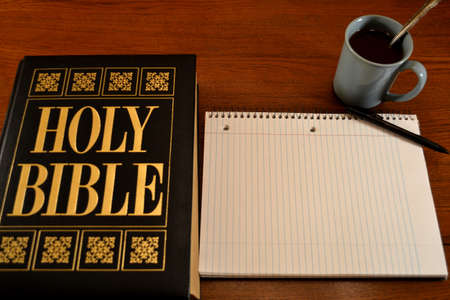Bible, notebook & coffee on table-1 (place for text on notebook) photo