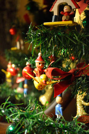 antique looking toy christmas ornaments on a tree like a toy santa on a - Antique Christmas Lights