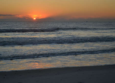 endings: The sun is almost up on a beach in Florida.