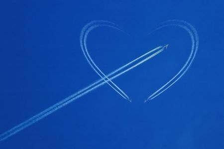 Blue sky with white jet and heart