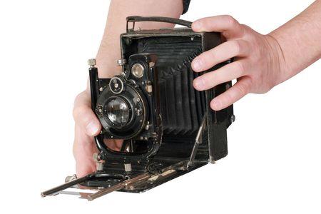 Vintage mechanical, studio,average format camera in hands photo
