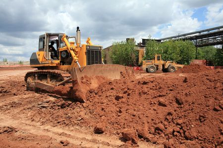 The heavy building bulldozer of yellow color photo