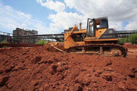 The heavy building bulldozer of yellow color Stock Photo