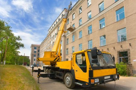 Heavy mobile crane truck working and blue sky photo