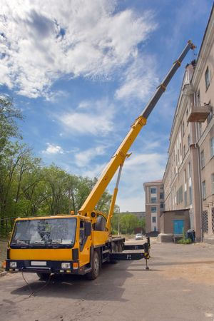 Heavy mobile crane truck working and blue sky Stock Photo