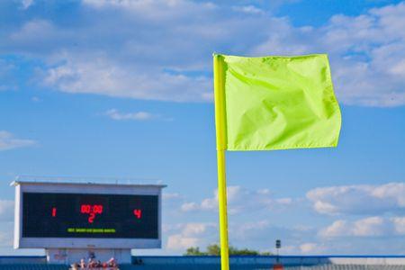 Flag, tablo at a stadium photo