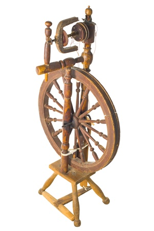 Old antique vintage traditional spinning-wheel,a distaff of the 19th century isolated on white background  Russia  photo