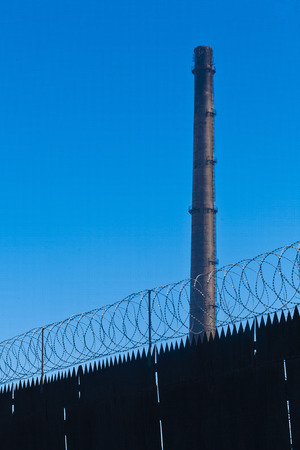 Original barbed and smoke industrial background. Stock Photo