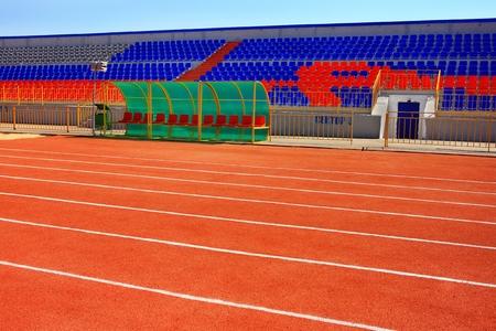 kickball: Football field with goal and tablo on blue sky