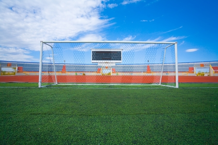 penalty flag: Football field with goal and tablo on blue sky