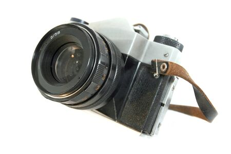 Old vintage black camera isolated on white background