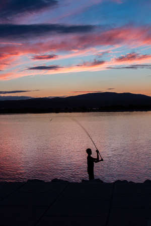 inshore fisherman at sunset, south of France