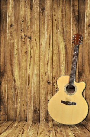 bluegrass: guitar on wood background