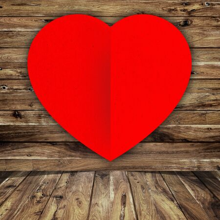 red heart on wood background  photo