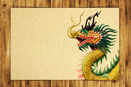 old grunge paper with dragon on wood background photo