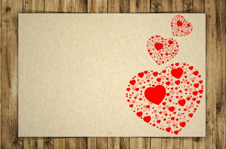 paper and red heart on wooden background photo