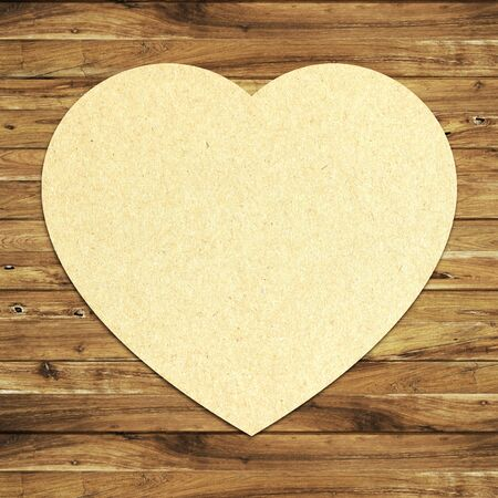 paper heart on wooden background photo