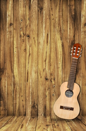 ukulele on wood background photo