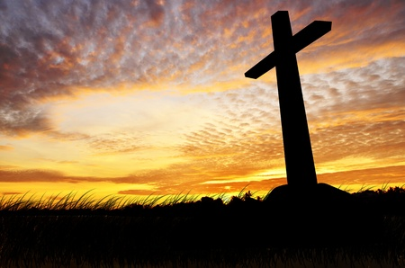 cross silhouette belive with the sunset as background crucifixion death