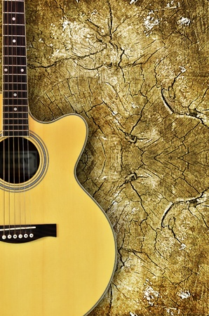 bluegrass: acoustic guitar on wood background