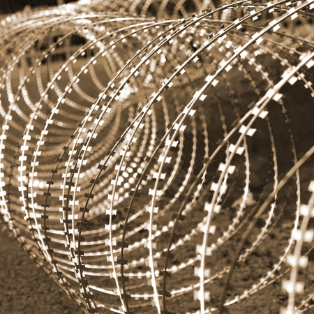 Barbed wire in sepia photo