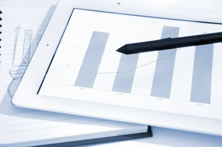 business chart and touch screen tablet-pc  Stock Photo - 12927614