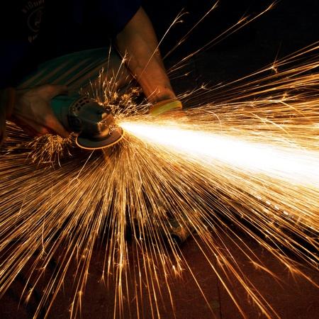 kıvılcım: Worker making sparks while welding steel  Stok Fotoğraf