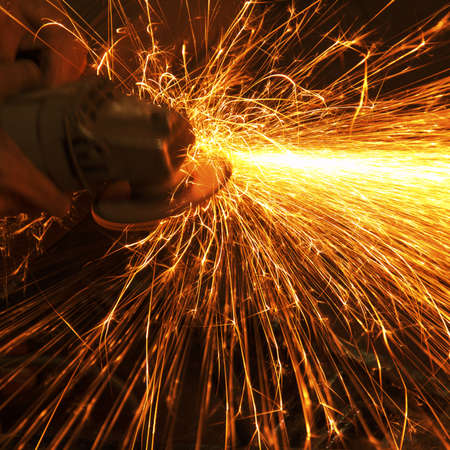 Worker making sparks while welding steel Stock Photo - 13055799