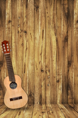 acoustic ukulele: ukulele on wood background