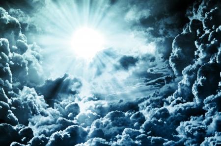 god in heaven: dark sky with sun Stock Photo