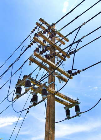 power distribution: electricity post in blue sky Stock Photo