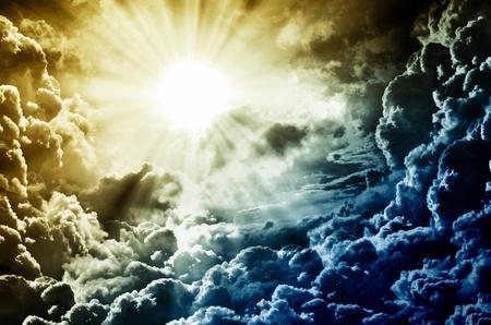 black jesus: dark sky with sun Stock Photo