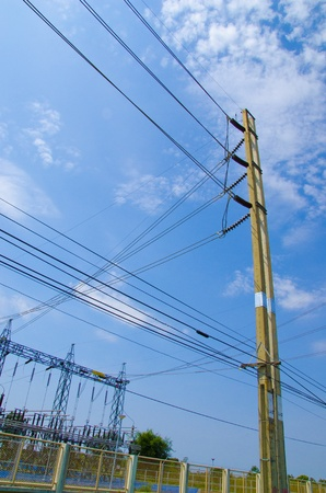 isolator high voltage: Electric power station in blue cloudy sky  Stock Photo