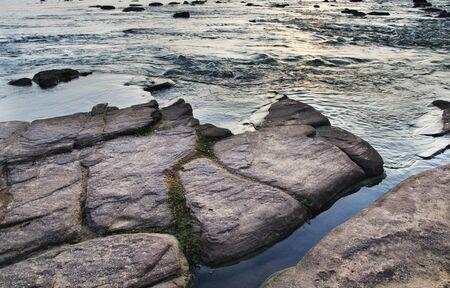 rushing water: Rushing water flowing over rocks